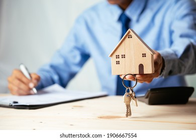 House model with real estate agent and customer discussing for contract to buy house, insurance or loan real estate,real estate concept.