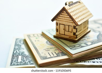house model set on banknote for concept investment mortgage fund finance and home loan