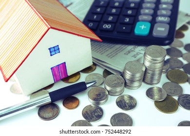 House model and stack of money and calculator on white background ,finance concept.