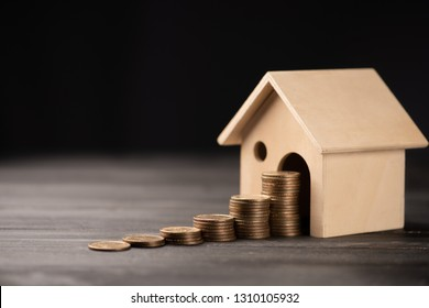 House model and stacking 1 US dollar coin.Business finance and Home loan concept.