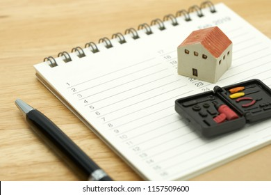 House Models and Equipment Models placed on a Book Rankings (list). Home Repair and Construction . using as background property real estate concept with copy space for your text or design.