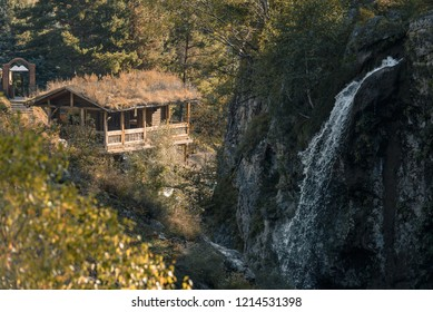 house in the mountains by the waterfall