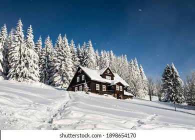 House in the mountains at frozen winter day.  - Shutterstock ID 1898654170
