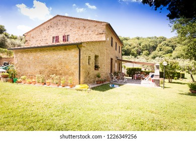 House of natural bricks under blue sky