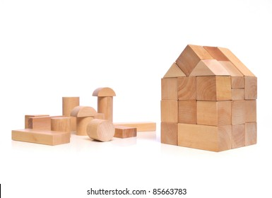 House of natural colored toy blocks on white background