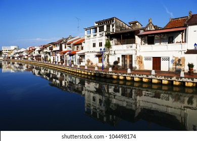 House near river under blue sky in Malacca  Malaysia