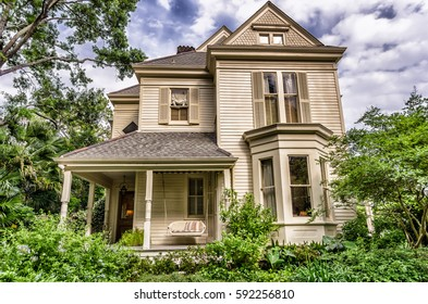 House in New Orleans LA USA Outlined with blue sky and clouds