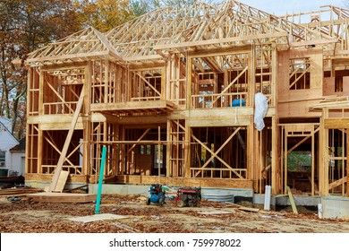 The house is new in wood roofing Single Family Home Construction - Building a New Wood Framed House