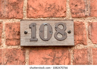 House number 108 sign on wall