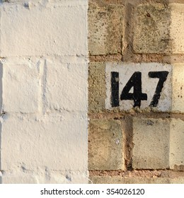 House number 147 sign