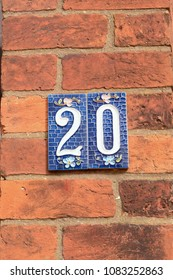 House number 20 sign on ceramic tiles on wall