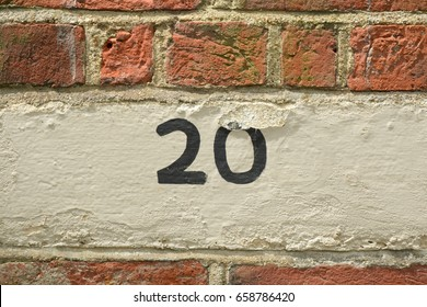 House number 20 sign painted on wall