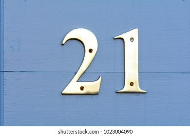 House number 21 sign on wall
