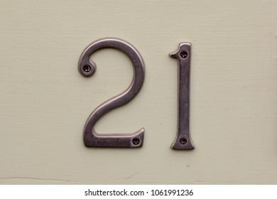 House number 21 sign in stainless steel fixed to wall