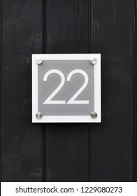 House number 22 on wooden wall happy new home moving away modern door number twenty two