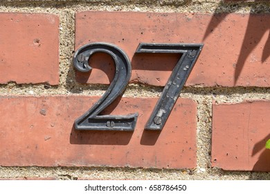 House number 27 sign on wall
