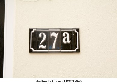 House number 27A sign on wall in ceramic tiles