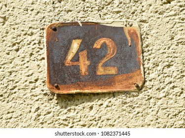 House number 42 on the wall of a building