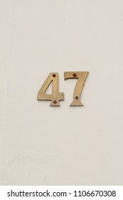 House number 47 sign on wall