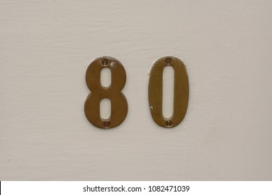 House number 80  sign on door