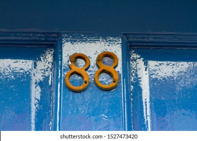 House number 88 on a blue wooden front door