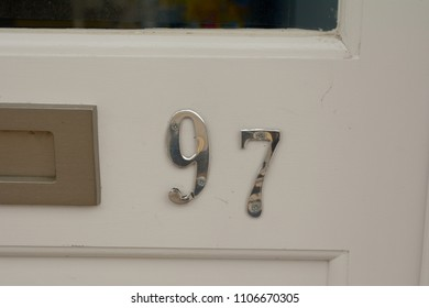 House number 97 sign on door