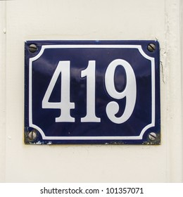 house number four hundred nineteen on an enameled plate
