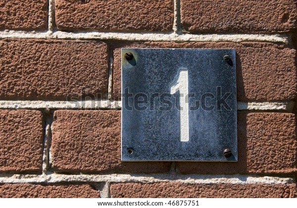 House number, No. 1 on a red brick wall