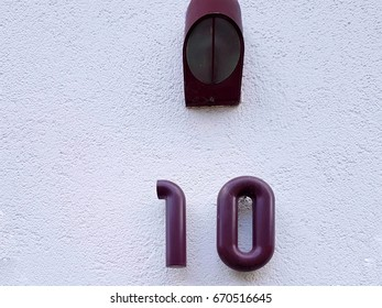 House number on the wall ten 10