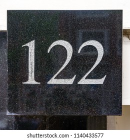 House number one hundred and twenty two (122)