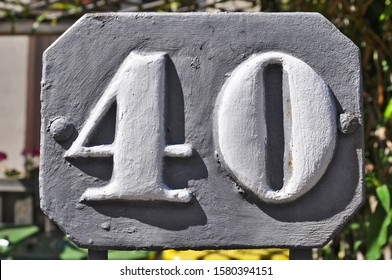 A house number plaque, showing the number forty (40)