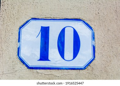 house number ten, tenth ( 10 ) on a roughcast wall