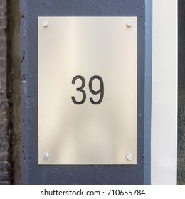 House number thirty nine (39) engraved in a  metal plate.