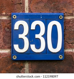house number three hundred and thirty. White lettering on a blue background.