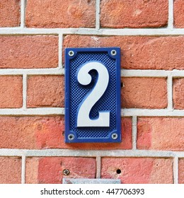House number two on a red brick wall