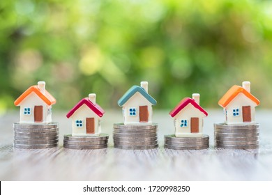 House on the coin ladder Real estate concept, mortgage and investment, save money or invest for future home, area to enter text.