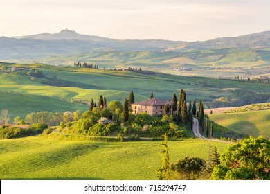 House on a hill in Tuscany landscape