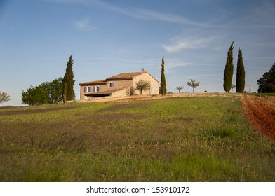 A house on a hilltop in Provence countryside at sunset, France, Europe