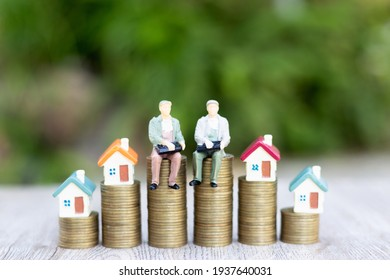 The house on the ladder A model businessman on a pile of coins Business Startup Ideas Mortgage and Real Estate Investing Money Savings Investing Risks.