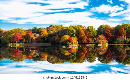 house on a lake in autumn