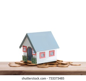 House on a pile of coins,money