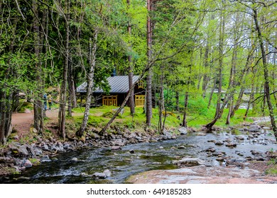 House on the river bank in the forest.