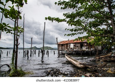 House on the sea and a boat parked near it, in Jayapura, West Papua, Indonesia