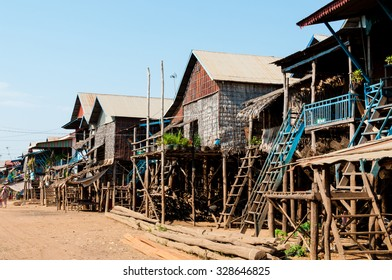 House on stilts with street in Cambodia