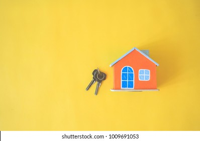 House on yellow background. Minimal creative style.
