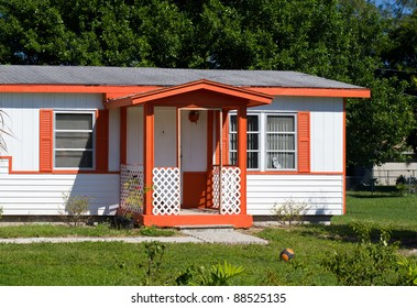 House with orange trim and window shutters
