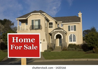 house is out of focus with for sale sign in foreground focused