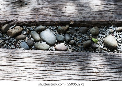House Patio modern gazebo Pebble Stone in the middle of wood path way exterior garden landscape architecture close up horizontal with shade shadow from the leaves of sun light-Picture of Patio