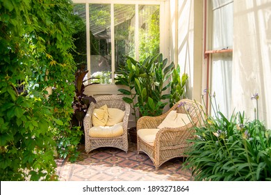 House patio with wicker chairs and green plants