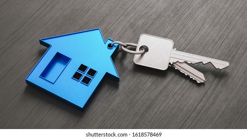 House as a pendant on a key on dark table as a house purchase and housing concept